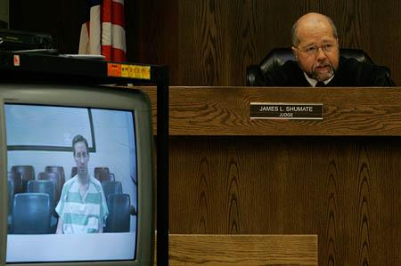 Warren Jeffs' image is seen on closed circuit TV as Judge James L. Shumate presides in 5th District Court in St. George.