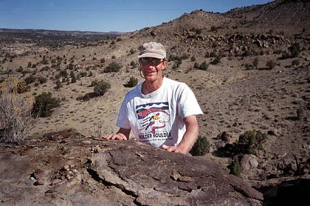 Don DeBlieux, above left, of the Utah Geological Survey, stands in Grand Staircase Escalante National Monument near the skull he discovered from an 80-million-year-old horned dinosaur. Utah researchers have reconstructed the skull of a new horned dinosaur from remains found at the site.