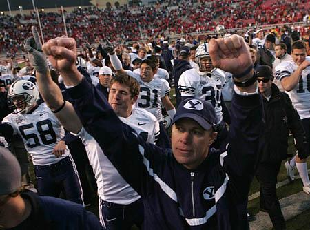 BYU coach Bronco Mendenhall acknowledges Cougar fans as the team leaves the field.;