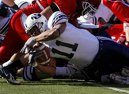 Brigham Young running back Manase Tonga stretches across the goal line for the Cougars' first touchdown of the game.
