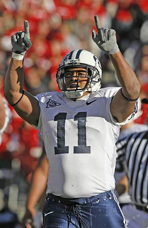 Cougar running back Manase Tonga celebrates his first-quarter touchdown during BYU's first possession of the game.