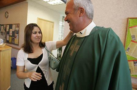 The Rev. Steve Klemz gets ready for Sunday services with help from his wife, Norma. The problems of immigration became personal after his marriage to Norma, an undocumented immigrant from Mexico.