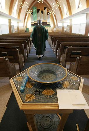 At left, he walks through Zion Lutheran Church in Salt Lake City before services.