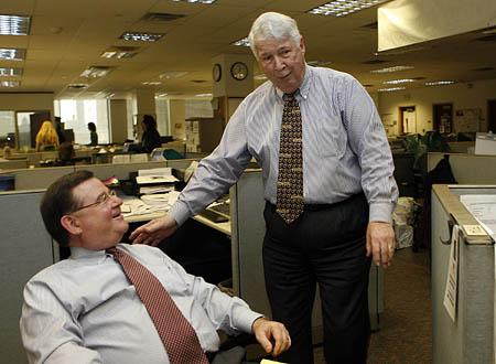 John Hughes, right,  retiring editor of the Deseret News talks to his new replacement Joe Cannon in the newroom Friday.