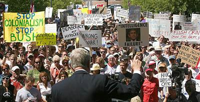 Hundreds of anti-Bush, anti-war protesters led by Salt Lake City Mayor Rocky Anderson and other political activists rally at Washington Square on Wednesday.