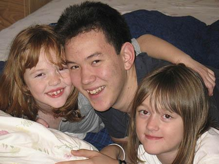 Chris Gulbraa hangs out with two of his biggest fans, twin 7-year-old half sisters Natalie, left, and Stephanie, right.