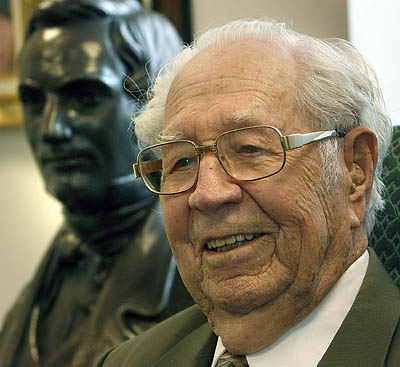 Eldred G. Smith, the patraich of the Church of Jesus Christ of Latter-day Saints, turns 100 on Jan. 9, 2007. Here, he sits in his office at the Joseph Smith Building, with a bust of his ancestor Hyrum Smith behind him.