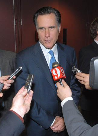 Former Massachusetts Gov. Mitt Romney answers questions from reporters after taking a tour of the Shooting, Hunting and Outdoor Trade Show in Orlando, Fla., Friday, Jan. 12, 2007.  Romney has formed a presidential exploratory committee for the 2008 election.