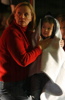 Lindsay, Sharifi holds her neice, Madeline Bayly, 4, they were in the mall when the shootings occured.