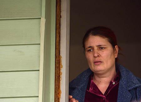 Sabira Talovic, the mother of Trolley Square gunman Sulejman Talovic, stands dazed in the doorway of her Salt Lake City home Thursday.