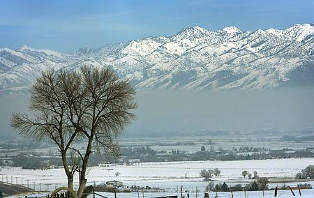 A layer of smog settled in the Cache Valley Tuesday afternoon where air quality was some of the worst in the nation.