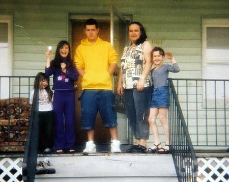 Sulejman Talovic stands with his mother and three sisters outside the family's home in Salt Lake City in happier days.