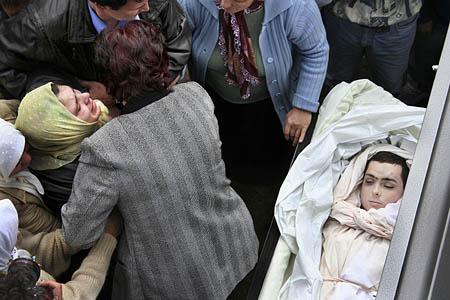 Sabira Talovic collapses at the funeral of her son, Sulejman, in the village of Talovici near Tuzla, Bosnia.