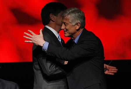 Radio talk show host Sean Hannity, left, hugs Salt Lake City Mayor Rocky Anderson after the debate at Kingsbury Hall on Friday.