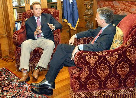 Gov. Jon Huntsman Jr., right, meets with California Gov. Arnold Schwarzenegger in Salt Lake City on Monday. Schwarzenegger was in Utah to sign the Western Regional Climate Action Initiative, an accord designed to find ways to cut greenhouse gas emissions without hurting the economy.
