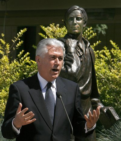 LDS Apostle Dieter Uchtdorf talks about missionary service at the Missionary Training Center in Provo during a press conference announcing that a million missionaries have served since the organizaioin of the church. A bronze statue of Joseph Smith's brother Samuel Smith, who was the first LDS missionary, stands behind Uchtdorf.