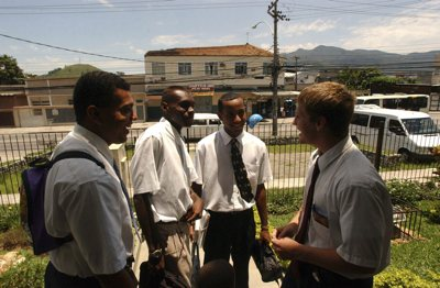 Elder Haws, right, chats with members of the bangu Branch on the steps of the chapel in Agua Branca, Rio De Janeiro Brazil.