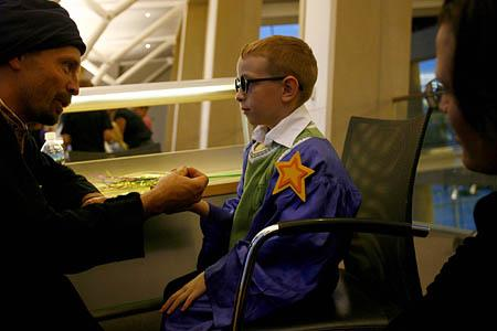 Dominic Barbieri, 6, has his palm read by