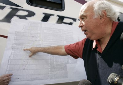Robert E. Murray, founder and chairman of Cleveland-based Murray Energy Corp, points on a map Monday to where six trapped coal miners are believed to be in his Crandall Canyon Mine, northwest of Huntington.