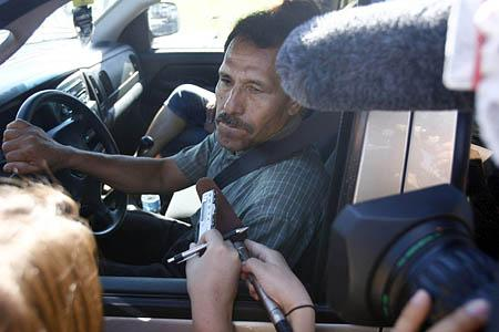 Tomas Hernandez, the uncle of trapped mine Luis Hernandez is interviewed by reporters after the morning update with Crandall Canyon Mine owner Robert Murray at Canyon View Junior High School.