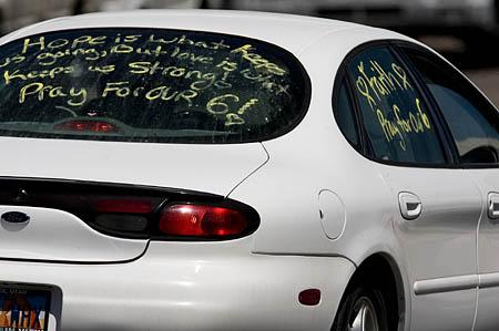 A car leaving the rescue efforts briefing at Canyon View school spells out the families' feelings.