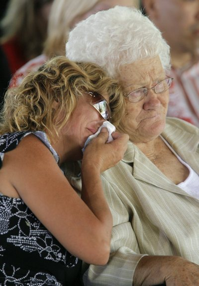 Dale Black's wife Wendy mourns as she leans on Black's mother Earlene during his funeral service at the Little Bear campground near the Crandall Canyon Mine, where six coal miners have been trapped since Aug. 6. Black was one of three rescuers killed during a collapse at the mine last Thursday.
