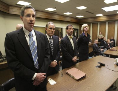 Warren Jeffs, left, and council react to the verdicts Tuesday in St. George, Utah. Jeffs, head of the Fundamentalist Church of Jesus Christ of Latter Day Saints, was found guilty on both counts of rape as an accomplice for allegedly coercing the marriage and rape of a 14-year-old follower to her 19-year-old cousin in 2001. Left to right is Jeffs, defense attorneys Richard Wright, Walter F. Bugden and Tara L. Isaacson, as prosecutors Brock Belnap and Ryan Shaum listen while seated.