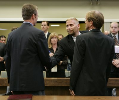 Prosecutor Brian Filter, center, shakes hands with prosecutor Brock Belnap, left, as prosecutor Ryan Shaum looks on after the verdict in Warren Jeffs' trial Tuesday in St. George, Utah. Jeffs, head of the Fundamentalist Church of Jesus Christ of Latter Day Saints, was found guilty on both counts of rape as an accomplice for allegedly coercing the marriage and rape of a 14-year-old follower to her 19-year-old cousin in 2001.
