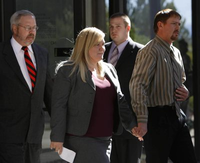 Elissa Wall, center, leaves court to make a statement to the media. Warren Jeffs was found guilty on two counts of rape as an accomplice Tuesday in St. George for allegedly coercing the marriage and rape of then-14-year-old Wall to her 19-year-old cousin in 2001.