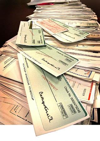 A stack of phony checks collected by Wells Fargo's Mountain Midwest Regional Services.