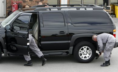 Security checks the car of Lt. Governor Gary Herbert as he arrives to meet Vice President Dick Cheney at the Salt Lake Jet Center on Friday to speak at a private luncheon for the Council for National Policy at the Grand America Hotel.