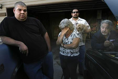 Larry Rougle's brother, David, left, mother, Nancy, uncle, Fernando Lopez, and father, Ismael, talk about Larry at their home in West Valley on Wednesday.