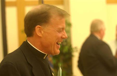 The Rev. John Wester laughs after addressing the St. George Area Chamber of Commerce on Wednesday.