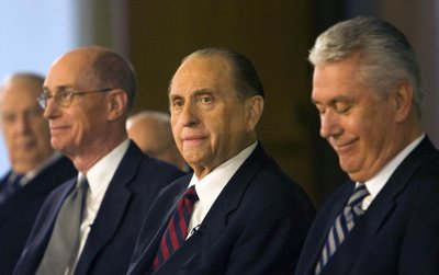 Thomas S. Monson, center, is flanked by Henry B. Eyring, first counselor, left, and Dieter F. Uchtdorf, second counselor, after Monson was named 16th LDS Church President Monday at the LDS Church Office Building in Salt Lake City.