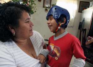 Jose Rodriguez smiles at his grandmother Leoncis Rodriguez at their home in Palmdale, CA.