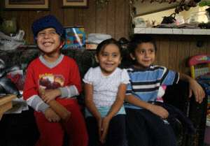 The Rodriguez kids, (L-R) Jose, Mona, and Emilio, at their home in Palmdale, CA.