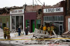 Emergency crews board up store fronts in Wells, Nev., following an early morning earthquake. Portions of Wells crumbled in the early morning hours  Thursday following a magnitude 6.0 earthquake.