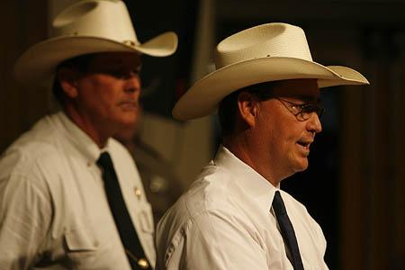 Schleicher County Sheriff David Doran, right, joined by Texas Ranger Capt. Barry Caver, speaks Thursday during a news conference in San Angelo, Texas.
