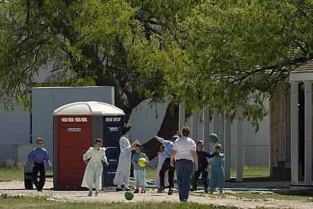 FLDS women and children play at Fort Concho in San Angelo, Texas, where they are being housed temporarily after the police removed them from the sect compound near Eldorado. The locked gate at the entrance to the Yearning for Zion Ranch in Eldorado, Texas.