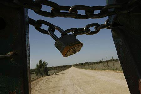 The locked gate at the entrance to the Yearning for Zion Ranch in Eldorado, Texas.