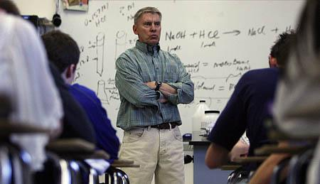 Bingham High School chemistry teacher Barry Lehto works with students Wednesday. Despite teaching chemistry for 34 years, Lehto may not qualify for the extra pay the Legislature set aside for teachers. It turns out few science and math teachers would.