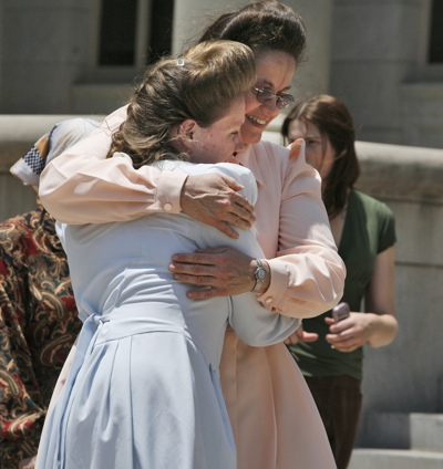 Fundamentalist Church of Jesus Christ of Latter Day Saints mothers hug after the news of a court ruling in their favor in San Angelo, Texas, Thursday. An Austin, Texas appeals court ruled that the state had no cause to take their children.