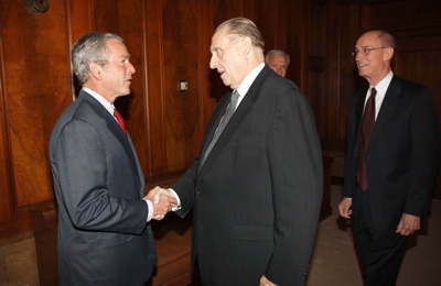 President George W. Bush greets Thomas Monson, President of The Church of Jesus Christ of Latter-day Saints, at the church s headquarters in Salt Lake City on Thursday. Also pictured at right is Henry Eyring, First Counsel in the Counsel of Twelve.