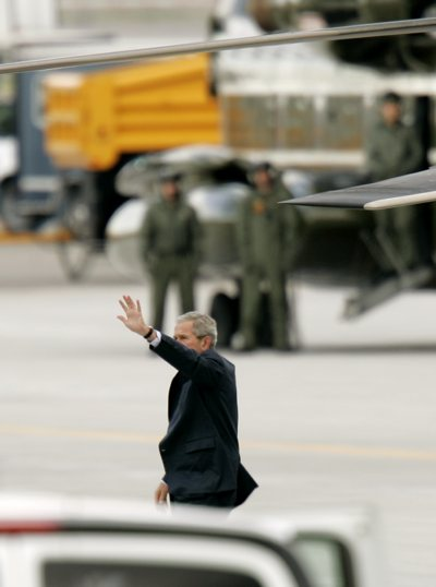 President Bush waves as he disembarks Marine One Thursday in Salt Lake City for a meeting with Mormon church leaders. The president visited Utah for two fundraisers Wednesday on behalf of Republican presidential candidate Sen. John McCain, R-Ariz.