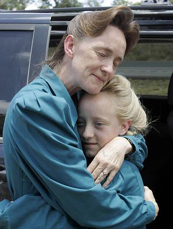 J Nancy Dockstader, an FLDS member, embraces her daughter Amy, 9, after they were reunited at the Baptist Children's Home Ministries Youth Camp near Luling, Texas, on Monday. A judge on Monday ordered the return of more than 400 children taken from their parents at a polygamous group's ranch because of suspected abuse, bringing an abrupt end to one of the largest custody cases in U.S. history.