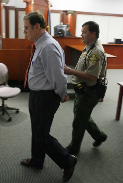 Val Southwick, who pleaded guilty to nine counts of securities fraud, is led away in handcuffs by a court officer after being sentenced at the Matheson Courthouse on Thursday. Southwick, 63,  was sentenced to one year to 15 years in prison. It will be up to the Utah parole board to determine just how long he is locked up.