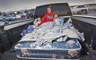 Amber Lowder and her two children Dylan, 3, and Baylee, 1, are ready to watch the double feature at Erda's Motor Vu Theatre.