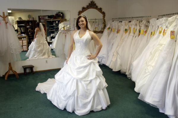 Kelsey Beacco Models Wedding Dresses At Angels Originals Consignment Shop On HIghland Drive In Salt