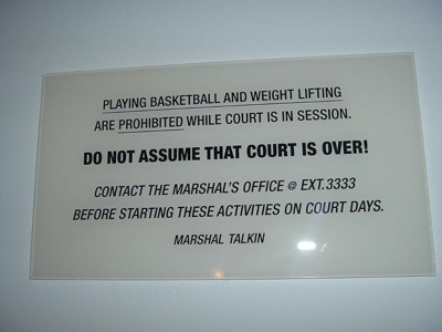 A sign outside of the Supreme Court's basketball court, prohibiting play while court is in session.