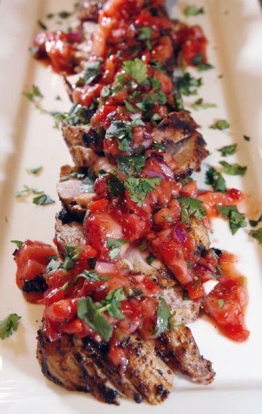 Salt Lake City -  Grilled pork tenderloin with grilled strawberry salsa was prepared by chef Cathie Mooere  at the Viking Cooking School in Salt Lake City Friday May 15, 2009.  Steve Griffin/The Salt Lake Tribune 5/15/09